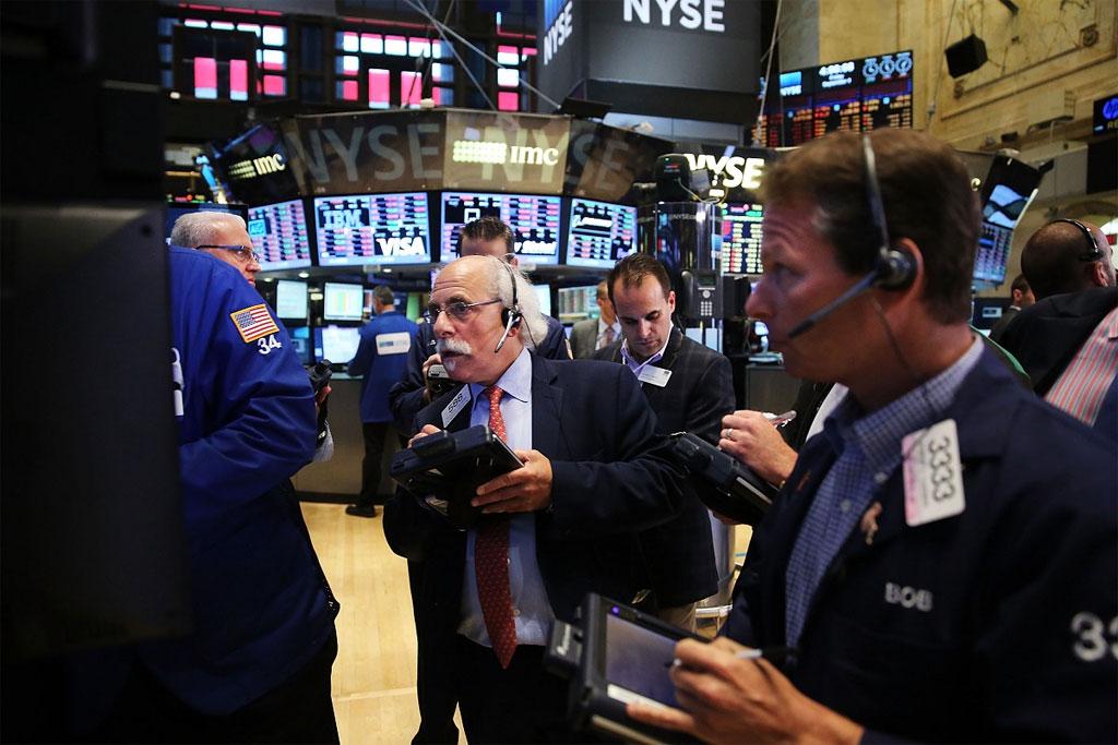 US stocks end higher Macys leads retailers down